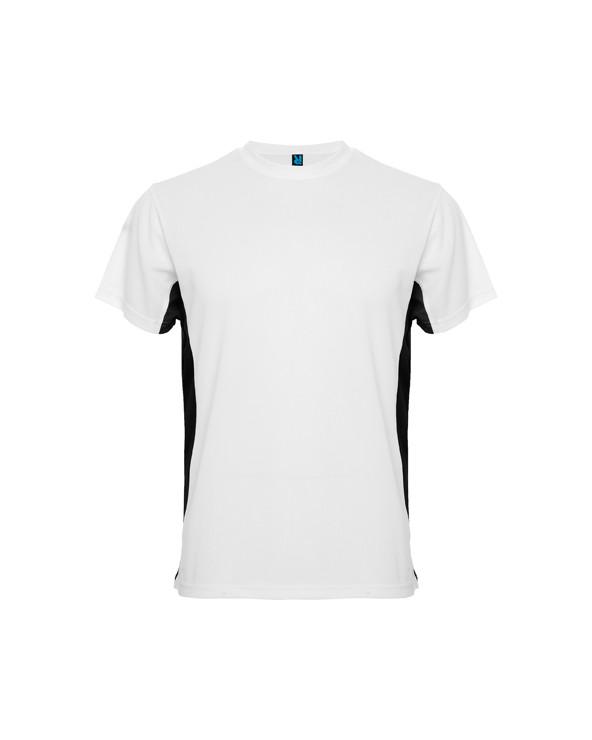 Camiseta técnica de manga corta combinada a dos colores. 1.- Escote redondeado con cubrecosturas. 2.- Laterales contrastados.