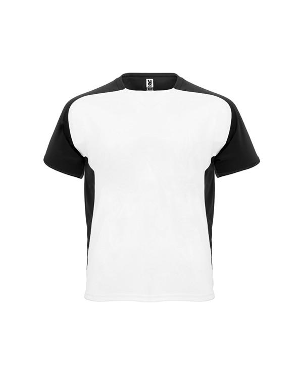 Camiseta técnica de manga corta ranglán.  1. Cuello redondo con cubrecosturas a tono.  2. Mangas y paneles laterales a contra