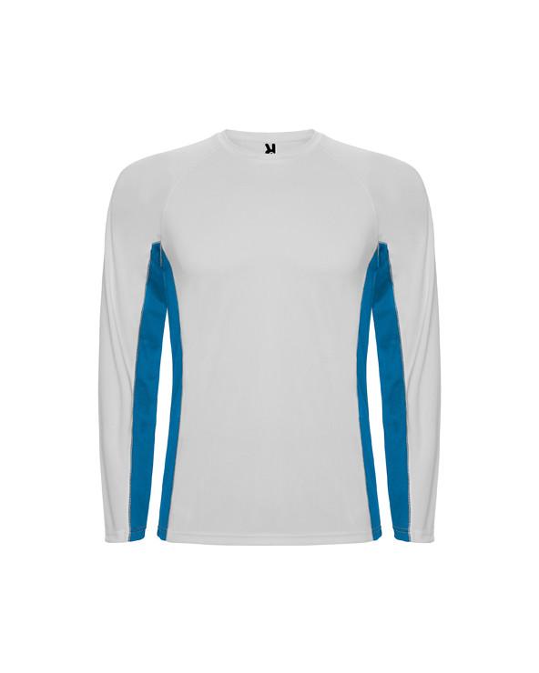 Camiseta técnica combinada, con dos tejidos de poliéster. Manga larga de estilo ranglán. Tejido principal bird´s eye y paneles